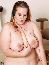 Gorgeous blonde BBW bares it all in her office room to examine her wet snatch with a dildo