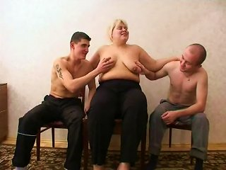 Chubby Cougar Likes To Suck One Guy While Bouncing On Another