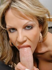 Kelly Madison takes a big cock in her mouth in a POV scene.