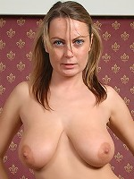 Alexis May plays with her juggs and fingering her moist twat