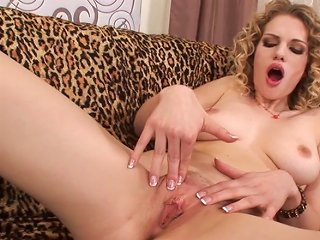 Curly-haired Busty Babe Shows Her Vagina