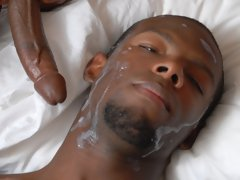 Horny black guy gets a huge facial shot