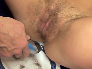 Watch This Gorgeous Brunette Shaving Her Perfect Pussy