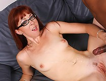 Slut with glasses gets two big black cocks in her pussy at the same time.