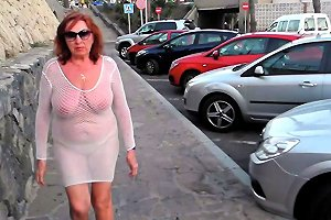 Beautiful Mature Slut Walks Around The City With Naked