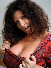 Big breasted housewife getting wet