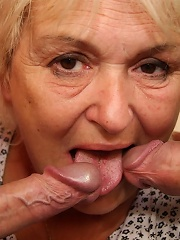 Hot old cleaning lady is on their bed with a dick in her seeping pussy and mouth