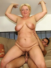The young man happily pushes his dick into this beautiful old babe and she loves it