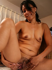 42 year old Dez strips and spreads her furry pussy in the laundry room