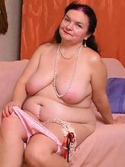 Nasty hot plump granny get naked in bedroom