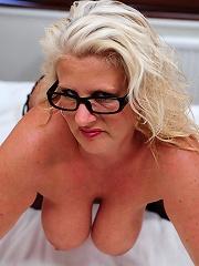 Big breasted MILF getting horny