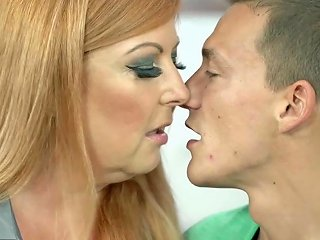 Busty Redhead Granny Pleasures Her Young Lover Like A