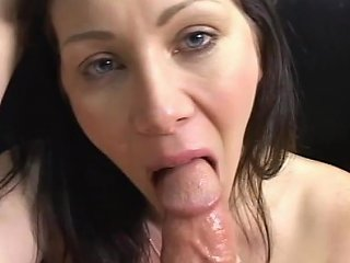 Busty Brunette Blowing His Cock