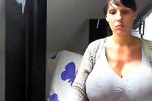 Hot Brunette Hiding Her Massive Boobs
