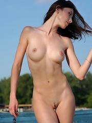 Zemani.com Katya - Teen Katya with a fantastic body poses nude on the sand.