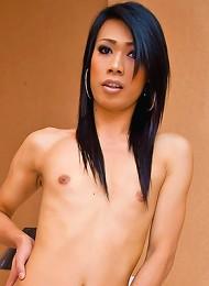Stockinged Asian t-girl May boasts her big hard-on
