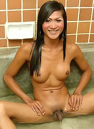 Bathtub fun for this ladyboy as he shaves cock clean