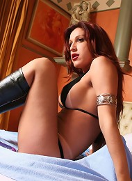 Redheaded shemale with big tits in leather