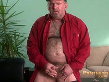 Older hairy daddy strokes his cock in front of camera