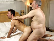 Clean-cut boy Cameron Kincade spies his daddy Luciano taking a nap naked on the bed. Cameron wakes his daddy by sucking on his big man meat. Luciano i